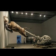 Bull fart sculpture by Artist Chen Wenling. Chinese Artist Chen Wenling made it to dig at the global financial crisis. The strong and farting bull represents Wall Street (in Chinese slang to fart mean to bluff or lie). And the man being shoved into the wall is Bernard Madoff who was sentenced to 150 years in prison because of Ponzi schemer.This could as well be compared the current finacial crisis situation in Kenya. by kenyacreativeweek