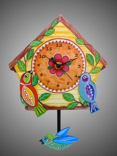 Birdhouse Pendulum clock handmade in America by Artist Terrie and Richard Floyd. Available at www.toymakerscollection.com