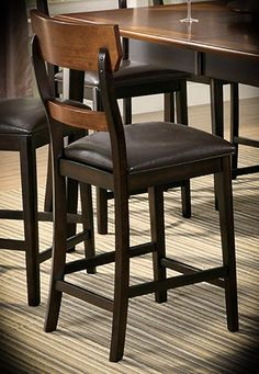 """Counter Height Barstool Franklin Two-tone Oak and Brown Width: 19.25"""" Height: 41.5"""" Depth: 20.5"""" This counter height dining chairs feature a two tone finish of Oak and Brown that is accompanied by a rich, dark brown vinyl seat upholstery for a transitional look. Chair backs are contoured and feature support planks for both the lower and upper back."""