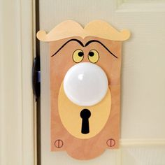 "-Talking Doorknob-  Take it from the talking doorknob Alice encountered in Wonderland, ""One good turn deserves another."" Made in the whimsical knob's likeness, this colorful paper doorknob plate is a handy prop for surprising your child and reciprocating for past April Fools' pranks!"
