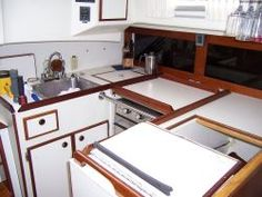 Wineglass storage above the freezer on a Pearson 365 Ketch