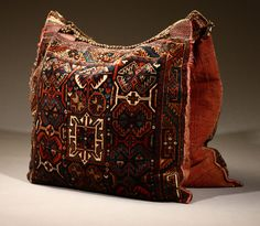 Lot# 1083 A Persian woven woolen camel bag. Of typical form, 54'' W x 26'' D, est: $500/800 *Price Realized: $1,035.00.