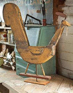 Folk Art Rooster: inspiration for creating distressed garden art via Country Living