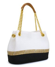 A woven straw design adds boho-chic style to this bag, while chain-accented handles add glittering edge. Zip and slip pockets organize essentials.