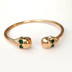 The Rescuers.  Emerald Green Skull Bangle - JewelMint
