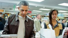President Obama, with his daughter Malia, buying books last weekend (Nov30/Dec1, 2013) at the Politics and Prose bookstore in Washington. (click to see some of what he bought)