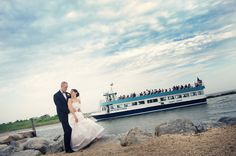 Land's End couple with the Sayville Ferry passing by #wedding #venue #waterfront #beach #longisland #newyork #realweddings