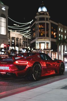Very fast beautiful metallic red sports card exotic car foreign car on the street part looks cool in the light cool car