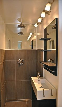 Shower/bathroom design for a Tiny House (or shipping container house). Note the drain along the wall as well as mirror above to make it more spacious.
