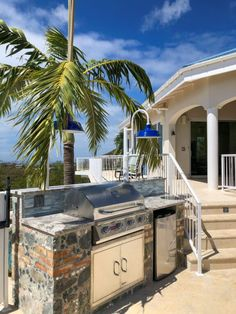 Post Top Lighting Blends Color, Style, Efficiency in Caribbean Renovation | Inspiration | Barn Light Electric Barn Lighting, Exterior Lighting, Outdoor Lighting, Barn Light Electric, Roof Colors, Dark Skies, Stunning View, Curb Appeal, Palm Trees