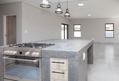 73 on Sleigh - Crontech Consulting Concrete Kitchen, Concrete Countertops, Freestanding Cooker, Copper Pendant Lights, Building Contractors, Kitchen Tops, Concrete Design, Rustic Industrial, Counter Tops