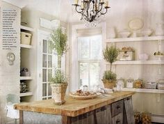 originally from Country Living Magazine... loving the minimal shabby look... topiaries are always a winner with me...