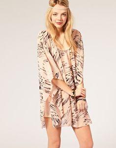 Reverse print cape dress
