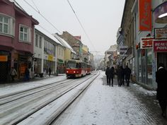 "Obchodná Uica (meaning ""Shopping Street"") in Bratislava is currently covered in a light dusting of snow."