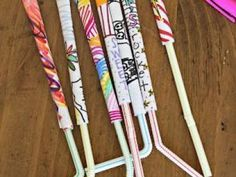 Paper Rockets   1. Decorate the paper.   2. Put glue on one of the longer edges. Then role the paper around a pencil starting from the opposite side.  3. Close the top of the rocket with scotch tape.  4. Insert a plastic straw and you are ready to go