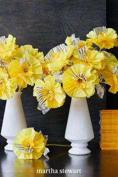 A triangular vase displays welcoming crepe-paper flowers in shades of yellow. Painted, striped petals and mottled-crepe leaves give each flower a layered look, as well as a wild personality. To add these details to the crepe paper, use a thin brush and a craft sponge. #marthastewart #crafts #diyideas #easycrafts #tutorials #hobby