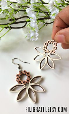 Do you like sporting unique & edgy designs but keeping it subtle & muted? Then these dangle earrings in the copper white combination, are a must have for you.Click through to purchase them or checkout more such interesting designs. Paper Quilling Earrings, Paper Quilling Flowers, Paper Quilling Designs, Quilling Paper Craft, Paper Jewelry, Paper Beads, Polymer Clay Jewelry, Quilled Creations, Unique Earrings