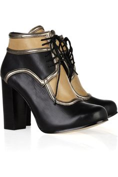 In a classic color combination of black and tan, DKNY's lace-up leather ankle boots are a perennially cool footwear choice. $177