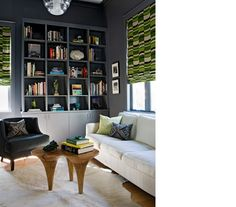 (designer angie hranowsky) love the green geometric, white hide rug, dk gray background which makes things pop, groovy, understated light fixture, awesome table)