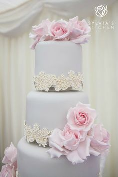 Sylvia's Kitchen | Becky www.sylviaskitchen.co.uk Four tier wedding cake at Broyle Place, Ringmer, East Sussex.  Iced in soft pale dove grey and decorated with hand made sugar lace, with a soft pearlised lustre finish and matt hand overpiping.  Tiers one two and three finished with pale pink sugar full bloom roses.  Image by @FitzG