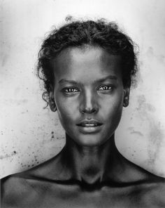 Beautiful Portrait portrait photo of Liya Kebede by Robert Maxwell. Black and white, grayscale, african black woman/ female portrait photography and professional headshot from front view, fashion editorial photography made indoor in a studio or outdoor in a forest in nature. Mostly upper-body close up photos of beautiful young women with natural smile and wonderful face, eyes and hair in clothes in the best pose. Ideas and inspiration for light and shadow, to create a high key photo.