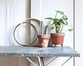 Giant Vintage French Industrial Ladle Planter / Rattan Wrapped. $48.00, via Etsy.