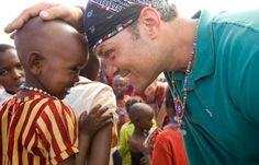 Baron Baptiste sharing yoga with children...