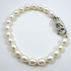 Tiffany & Co. Sterling Silver & Pearl Bracelet. Retails at $300. $225