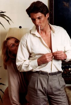A suave vision of style, Richard Gere gets dressed in a pair of pleated trousers and a dress shirt with a front pocket.