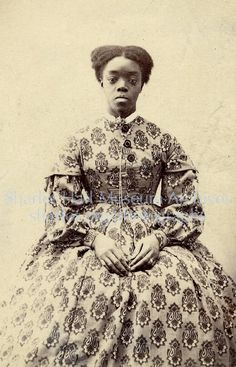 circa 1860s.  Yes, black women wore hoop skirt dresses as well.  The style was not exclusive to southern bells. Lovely.