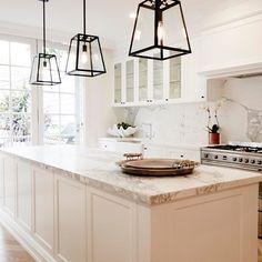 Lantern style pendant lights for kitchen.