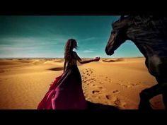 STING - DESERT ROSE 'I dream of rain I dream of gardens in the desert sand I wake in pain I dream of love as time runs through my hand'