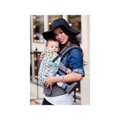 Tula Baby - Ergonomic Carrier - Equilateral Have fun in our cool geometric Tula, 'Equilateral'! A vivid pattern of triangles creates a mosaic of green and gray tones against a dark gray canvas. 'Equilateral' will have you feeling modern yet playful and hip!