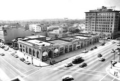 This is a view looking southeast at the block on Rodeo Drive ending at the northeast corner of Wilshire and Rodeo opposite from the Beverly Wilshire Hotel (1957). It was  a regular, flat block of low-rise stores anchored by a Wilson's House of Suede. Today it's a faux European-like walkway called Via Rodeo with an artificial hill in the middle.