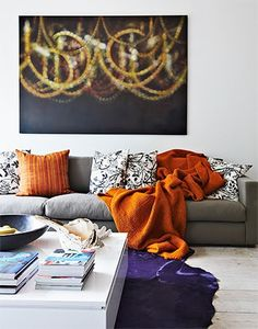 I am seeing a TON of neutral gray rooms with sparks of orange like this. Nice, elegant and easy. #colors #gray #orange