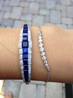 It's a vintage piece from the 20s made of white gold and platinum. There are old cut diamonds and sapphires galore!