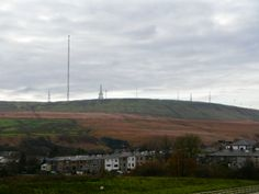 Winter Hill towering above Belmont. Winter Hill is the highest point in the area known as the West Pennine Moors. When I was tall enough I could see this view from Nanna's kitchen sink - wonderful
