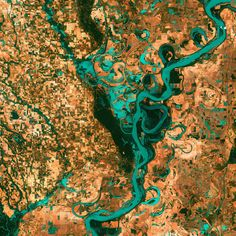 3rd Place: Meandering Mississippi - 28 May 2003 -  Small, blocky shapes of towns, fields, and pastures surround the graceful swirls and whorls of the Mississippi River, the largest river system in North America. Countless oxbow lakes and cutoffs accompany the meandering river south of Memphis, Tennessee, on the border between Arkansas and Mississippi.