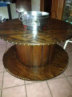 upcycled industrial spool coffee table with ice bucket . $175. @ https://www.facebook.com/pages/Que-Bonita-Boutique/448968621849194?ref=hl#!/photo.php?fbid=547530401993015&set=pb.448968621849194.-2207520000.1391103705.&type=3&theater
