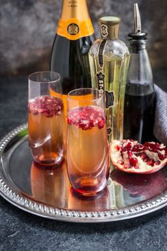 Three ingredients and 5 minutes is all you need to mix together this St. Germain and Pomegranate Champagne Cocktail to ring in the New Year! Champaign Cocktails, Fruity Cocktails, Winter Cocktails, Christmas Cocktails, Cocktail Drinks, Cocktail Desserts, Cocktail Ideas, Bourbon Drinks, Classic Cocktails
