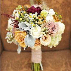 light mustard yellow, dusty blue, light orange, cranberry, and green Love the colors but no roses!