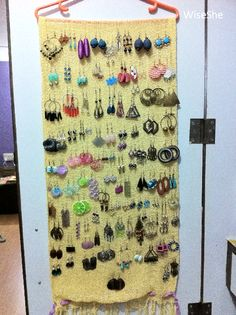 similar to what i do...i took a kitchen towel and nailed it to the wall with 4 little nails across the top and hang all my earrings on it