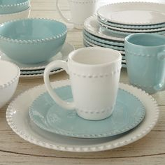 The aqua dinnerware is gorgeous and I love that it is paired with the same pattern plate but just in white! So pretty!