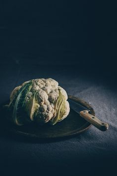 Whole Roasted Cauliflower - A vegan recipe inspired by my travels to Israel by Kati of black.white.vivid. - food photography, food styling, moody food photography, food blogger, food photographer, vegan recipe, vegan food, israeli recipe, israel, israeli cuisine