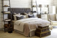 Love the ladder and suitcases and white painted wood walls...for me,  needs a boho touch with hanging tapestries, fabrics, and plenty of colorful pillows