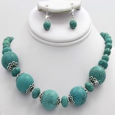 """GORGEOUS GENUINE TURQUOISE ROUND STONE NECKLACE SET WITH ROUND STONE TURQUOISE THAT GO FROM A NORMAL 1"""" ROUND STONE AND CASCADE DOWN IN SIZE AS IT TRAVELS UP THE NECK WITH FLAT DESIGNER SPARE BEADS AND SMALL ROUND SILVER TONE SPACERS BEADS WITH EARRINGS THAT MATCH PERFECTLY! THIS IS A CLOSE UP SHOT AND STONES ARE NOT AS LARGE AS THEY APPEAR! $23.00 INCLUDES SHIPPING PAY PAL OR SECURED INVOICE THANKS FOR LOOKING!"""