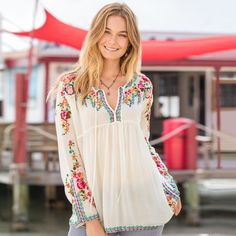 "FRANCESCA BLOUSE -- With gorgeous embroidery on yoke and sleeves, this breezy blouse evokes images of colorful gardens and island delights. Cutaway neckline and tie front. Rayon. Machine wash. Imported. Sizes XS (2), S (4 to 6), M (8 to 10), L (12 to 14), XL (16). Approx. 28""L."