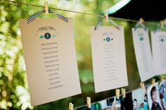 Seating charts hung with clothespins and gingham ribbon.