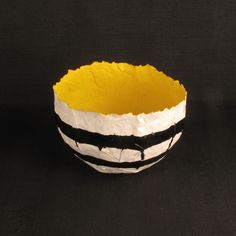 This Piňata bowl is part of Darkroom's Aztec range and inspired by traditional South American piňata's. It is made from moulded paper and hand-painted in the UK. Each one is unique and painted with a different interior colour and striking exterior design in black gloss.