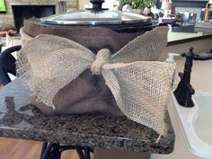 Burlap crockpot cover. Great for potluck dinners to hide the crockpots and gives your serving line or food table a more unified look.